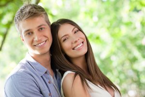 image of a man and a woman smiling and leaning on each other